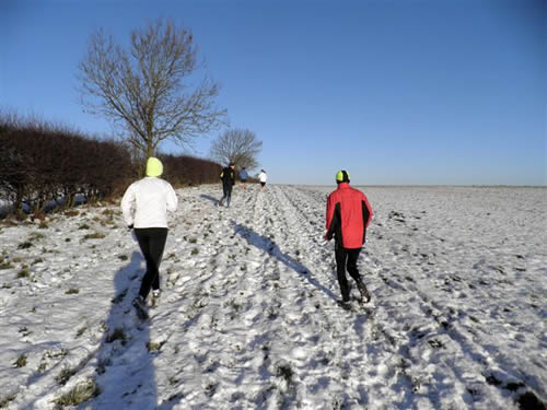 Snow running on the fields near Pitsford